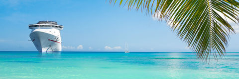 Cruise ship. Luxury cruise ship near tropical island Royalty Free Stock Photo
