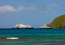 A cruise ship and luxury poweryacht at admiralty bay, bequia Royalty Free Stock Image