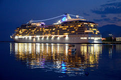 Cruise ship. Luxury cruise ship sailing from port after sunset Stock Image