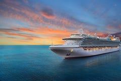 Cruise ship. Luxury cruise ship sailing to port on sunrise stock photo