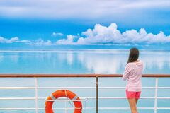 Free Cruise Ship Luxury Travel Woman On Deck Looking Away In Tahiti. Serene Still Ocean Water Landscape. Tourism Vacation Stock Photos - 194294573