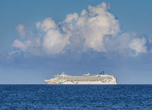 Cruise ship. Luxury white cruise ship with heliport and pools sailing on the sea Stock Images