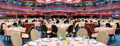 Cruise ship main dining room for over 1,000 seats is awaiting for new guests. Royalty Free Stock Images