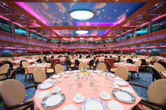 Cruise ship main dining room for over 1,000 seats is awaiting for new guests. Royalty Free Stock Photography
