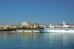 Cruise ship and Malaga waterfront. Royalty Free Stock Image