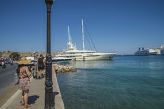 Cruise ship in mandraki harbour. Photo is shot when we were on vacation in Rhodes, Greece, September 2013 Stock Photography