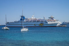 Cruise ship in mandraki harbour Stock Images