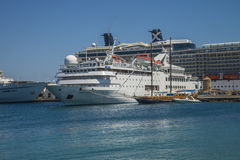 Cruise ship in mandraki harbour. Photo is shot when we were on vacation in Rhodes, Greece, September 2013 Stock Images