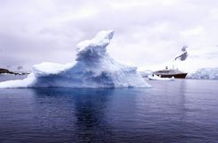 Cruise ship Marco Polo with glaciers and icebergs in Paradise Harbor, Antarctica Stock Photos