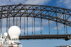 Cruise ship mast about to pass under Sydney Harbour Bridge Stock Photo