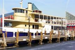 Cruise ship moored in Baltimore Inner Harbor's icy waters. Inner harbor of Baltimore in winter Stock Photo