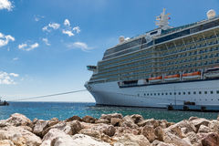 Cruise Ship Moored Beyond Stone Breakwater Stock Images