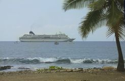 Cruise ship moored close to the beach Stock Image