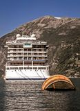 Cruise ship at Geiranger, Norway. Royalty Free Stock Images