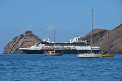 Cruise ship moored off the island of Nuka Hiva Royalty Free Stock Photography