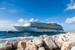 Cruise Ship Moored Past Rocks Royalty Free Stock Images