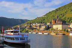Cruise ship on Moselle River. A river cruise ship on the Moselle river in the picture-postcard village Cochem, Germany Royalty Free Stock Images