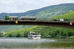 Cruise ship on the Moselle and road traffic on bridge Stock Image