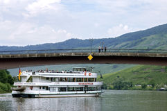 Cruise ship on the Moselle and sightseers on bridge Royalty Free Stock Images
