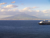 Cruise Ship and Mount Vesuvius. Cruise ship at anchor off the port of Sorrento Italy Royalty Free Stock Image