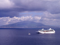 Cruise Ship and Mount Vesuvius. The Bay of Naples at Sorrento a popular port of call for cruises Stock Images