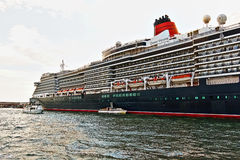 Cruise Ship MS Queen Victoria and boats Royalty Free Stock Image