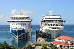 Cruise ships MS Royal Princess and MSC Fantasia in St. George`s, Grenada. Cruise ship MS Royal Princess in St. George`s port, Grenada.  MS Royal Princess is a Stock Photos