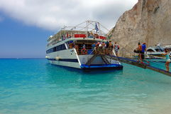 Cruise ship on Navagio beach Royalty Free Stock Image