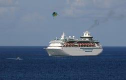 Cruise ship near coast Stock Images