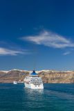 Cruise ship near island of Santorini Royalty Free Stock Photo