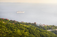 Cruise ship near Trieste. The cruise ship departs on a trip to the open sea from Trieste Italy Royalty Free Stock Photos