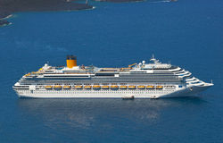 Cruise ship near volcano on island of Santorini Stock Photos