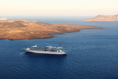 Cruise ship near volcano on island of Santorini Stock Image