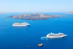 Cruise ship near volcano of Santorini Stock Photo