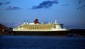 Queen Mary 2 Cruise Ship Brooklyn New York USA. Queen Mary 2 docked at Brooklyns Red Hook terminal at dusk stock photo