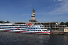 Cruise ship next to river station Royalty Free Stock Photos