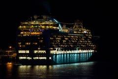 Cruise ship at night. Cruise ship in water illuminated at night Royalty Free Stock Photos