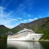 Cruise ship in norvegian fjiord Stock Photos