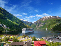 Cruise ship in norvegian fjiord Royalty Free Stock Images