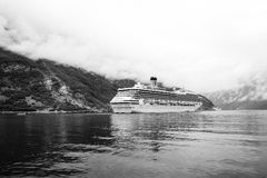 Cruise ship in norwegian fjord. Passenger liner docked in port. Travel destination, tourism. Adventure, discovery. Geiranger, Norway - January 25, 2010: cruise royalty free stock photography