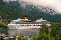 Cruise ship in norwegian fjord. Travel destination, tourism. Adventure, discovery, journey. Passenger liner docked in. Geiranger, Norway - January 25, 2010 royalty free stock images