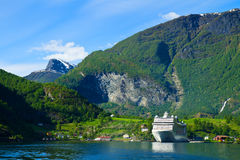 Cruise ship in Norwegian fjords Stock Images