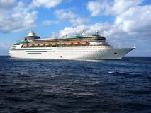 Cruise ship in ocean. A cruise ship anchored in the middle of the ocean Stock Photo