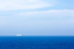 Cruise Ship on Ocean in Fog Stock Photo