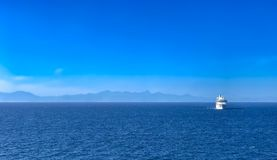 Cruise ship on ocean. A single cruise ship traveling on the ocean Royalty Free Stock Photography