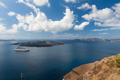 Cruise Ship off the coast of Santorini Greece Stock Images