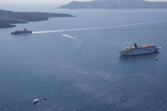 Cruise ship off the coast of Santorini. Santorini - one of the m Stock Photos