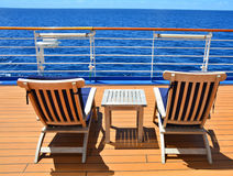 Cruise ship open deck. Sunbeds on open deck of cruise ship with wonderful ocean view stock photos