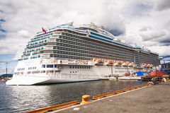 Cruise ship in Oslo habour beside Akershus Fortress Stock Image