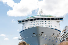 Cruise Ship Over Boulders with Ropes. Luxury Cruise Ship Beyond Boulders with Ropes to Pier Stock Photography
